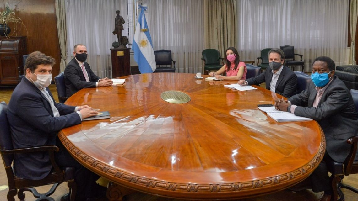 Representatives from the International Monetary Fund's (IMF) mission team. meet with government officials, including Economy Ministry Martín Guzmán, last week.