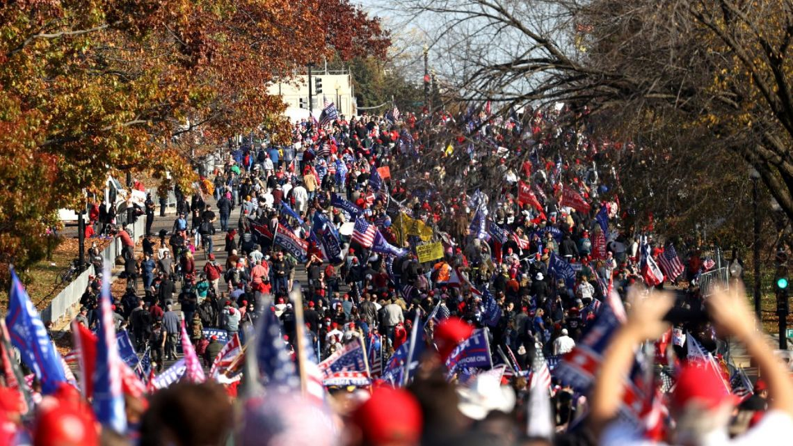 """People participate in the """"Million MAGA March"""" from Freedom Plaza to the Supreme Court, on November 14, 2020 in Washington DC."""
