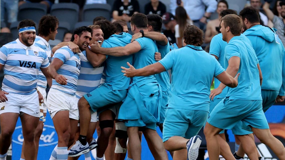 Argentina's players celebrate their victory at the end of the 2020 Tri-Nations rugby match between the New Zealand and Argentina at Bankwest Stadium in Sydney on November 14, 2020.