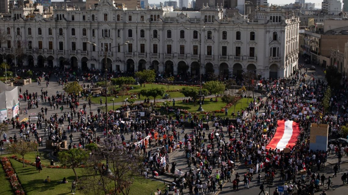 Demonstrators gather during a protest at Plaza San Martín in Lima, Peru, on Saturday, November 14, 2020. Peruvians have been protesting for days amid growing public indignation over the ouster of President Martín Vizcarra by the opposition in Congress.