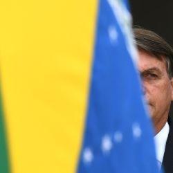El presidente brasileño, Jair Bolsonaro, asiste a la celebración del Día de la Bandera Nacional en el Palacio Planalto en Brasilia. | Foto:Evaristo Sa / AFP