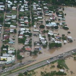 Vista aérea del municipio inundado de Chamelecón, en el Valle de Sula, en las afueras de San Pedro Sula, 240 km al norte de Tegucigalpa, luego del paso del huracán Iota. | Foto:Orlando Sierra / AFP