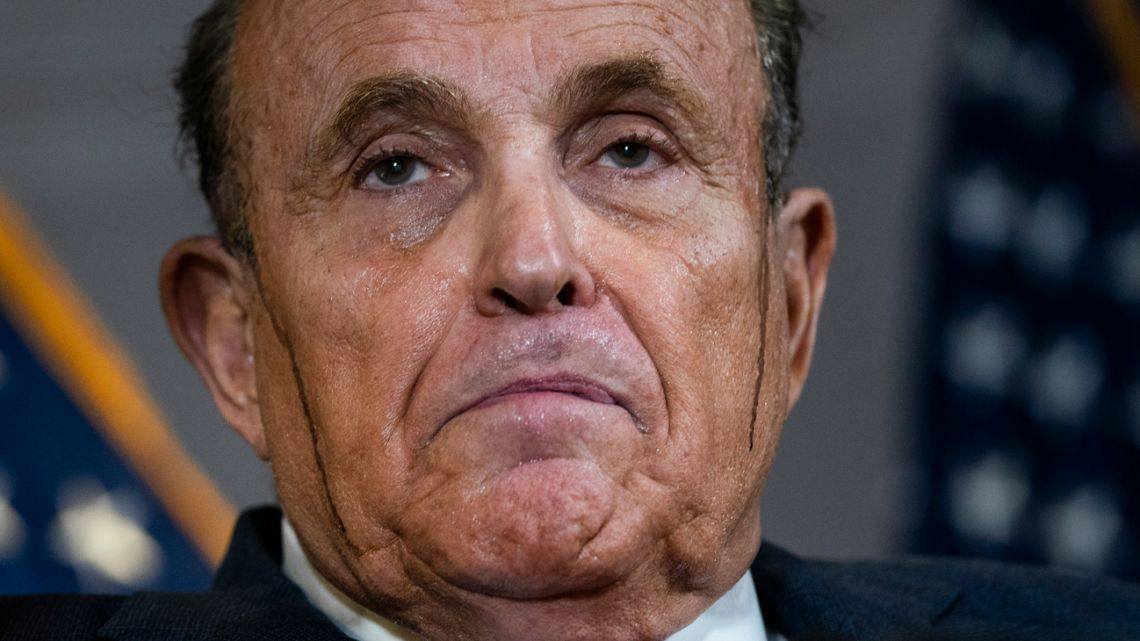 Rudy Giuliani sweats it out at a press conference to remember.