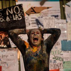 Los manifestantes participan en una protesta contra el gobierno, en Lima.   Foto:Ernesto Benavides / AFP