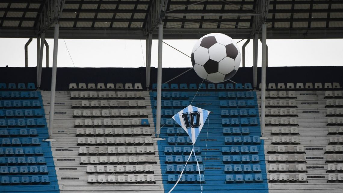 A helium balloon with the shape of a football and a kite in Argentine colours and the number 10 are displayed in tribute to Maradona, before a Copa Diego Maradona 2020 match between Racing Club and Union at the Presidente Perón Stadium in Avellaneda, on November 28, 2020.
