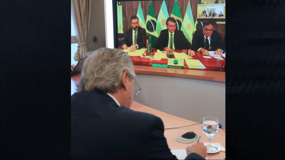 President Alberto Fernández and his team speak with Brazilian President Jair Bolsonaro and other government officials during a videoconference call.