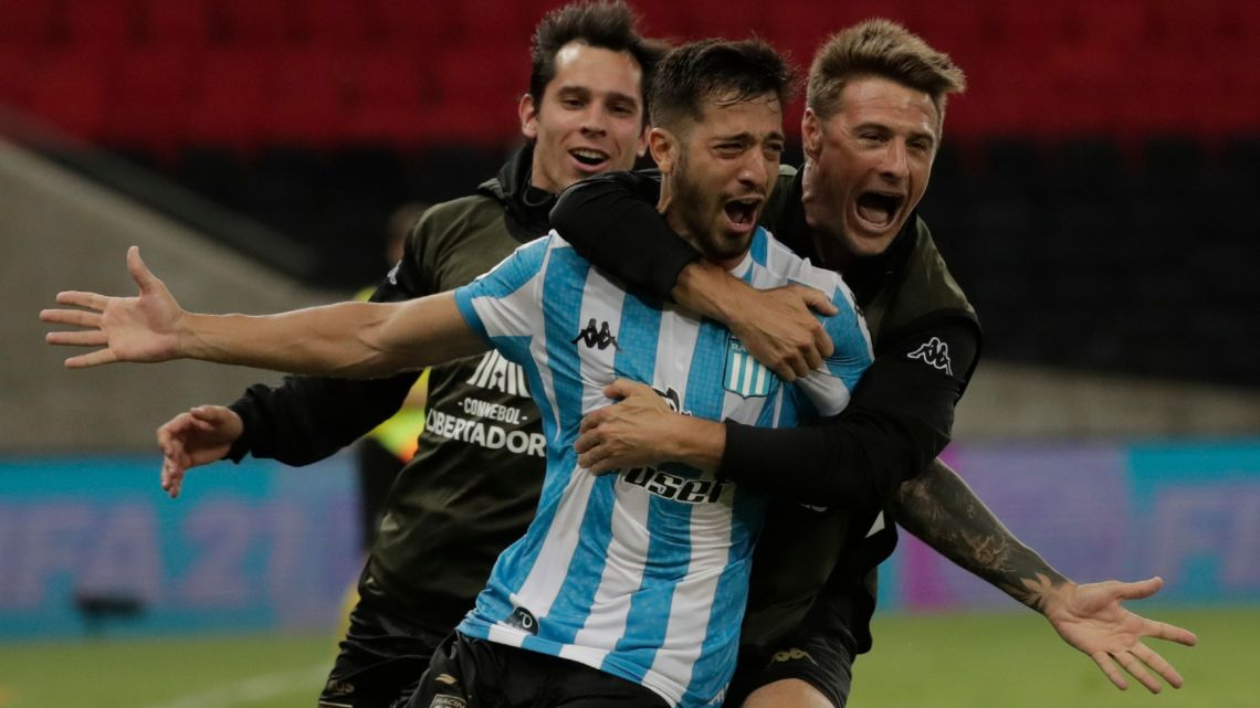 Racing Club's Fabricio Domínguez celebrates after scoring against Brazil's Flamengo during the penalty shoot-out of their closed-door Copa Libertadores round before the quarter-finals football match at Maracanã Stadium in Rio de Janeiro, Brazil, on December 1, 2020.