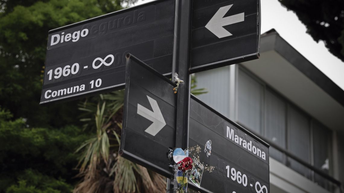 Two street signs in Buenos Aires, which have been altered by residents to pay tribute to late footballing great Diego Maradona.
