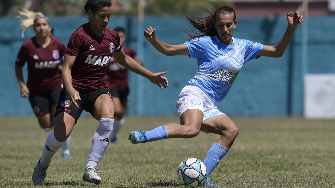 Mara Gómez of Villa San Carlos vies for the ball with Luciana Nievas of Lanús during a first division women's football match at the Genacio Salice stadium in Berisso, Buenos Aires Province.