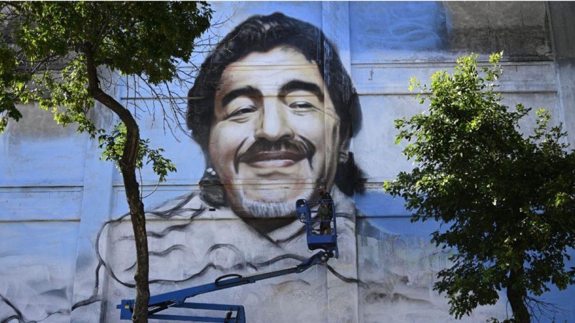 Street artist Alfredo Segatori paints a mural of late Argentine football legend Diego Maradona in La Boca.