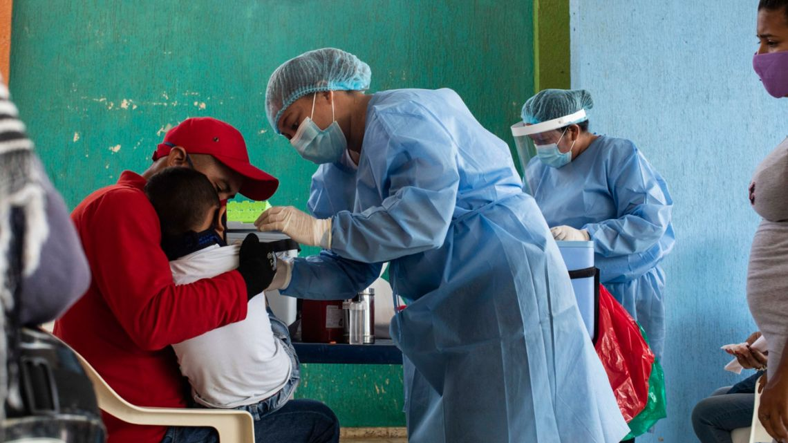 Healthcare workers of the San José Hospital mobile unit treat Venezuelan migrants at a closed school in Maicao, La Guajira, Colombia.