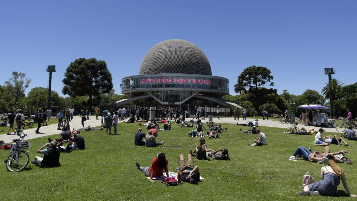People gather at the Galileo Galilei planetarium to watch the partial solar eclipse in Buenos Aires on December 14, 2020.