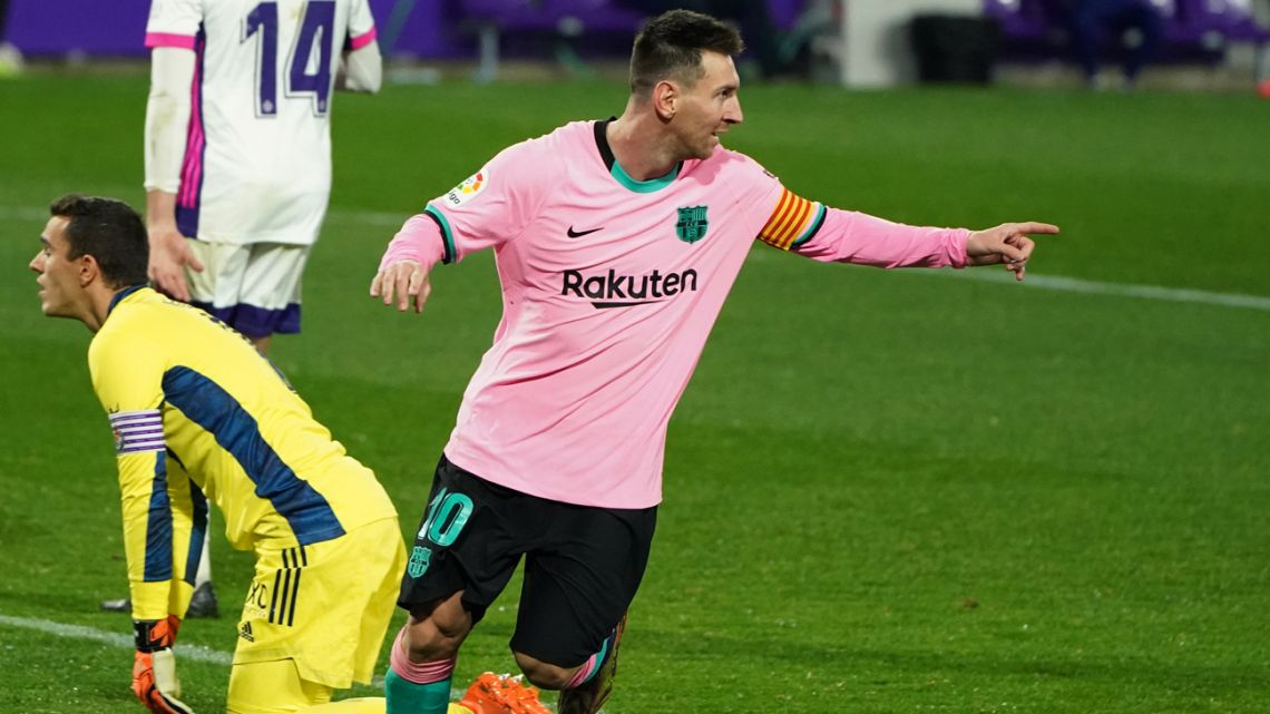 Barcelona's Argentine forward Lionel Messi celebrates after scoring a goal during the Spanish league football match between Real Valladolid FC and FC Barcelona at the Jose Zorilla stadium in Valladolid on December 22, 2020.