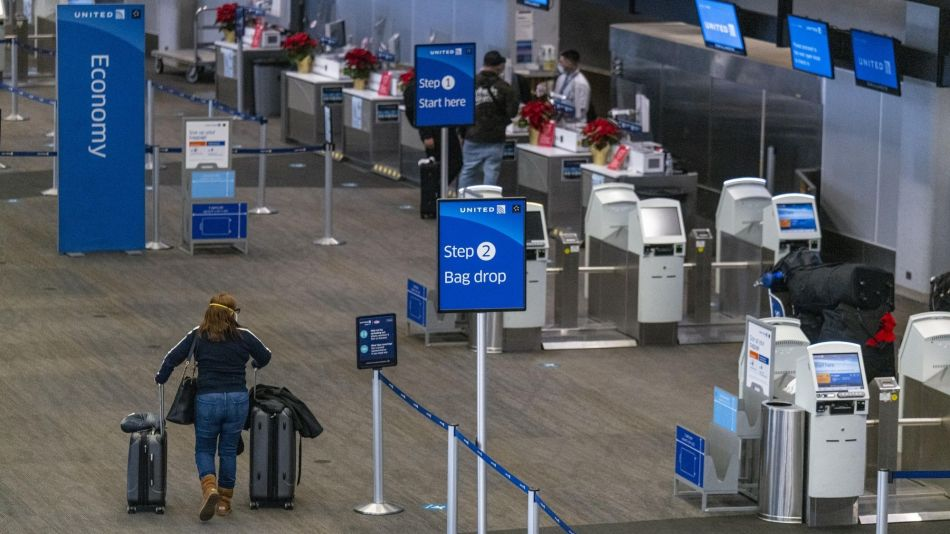 Travelers At SFO Airport Ahead Of Christmas Holiday