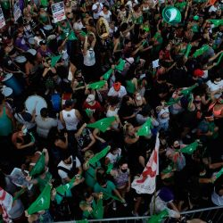 Aerial view showing abortion rights activists gathering outside the Congress as senators debate a landmark bill on whether to legalise abortions, on December 29, 2020.