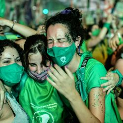 Pro-choice activists celebrate after the Senate approved a bill to legalise abortion outside the Congress in Buenos Aires on December 30, 2020.