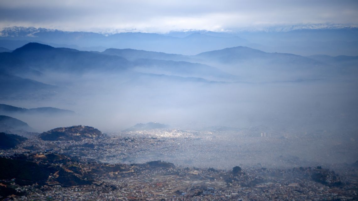 This general view shows low visibility due to air pollution in the urban area of the Kathmandu Valley, in Kathmandu on January 05, 2021.