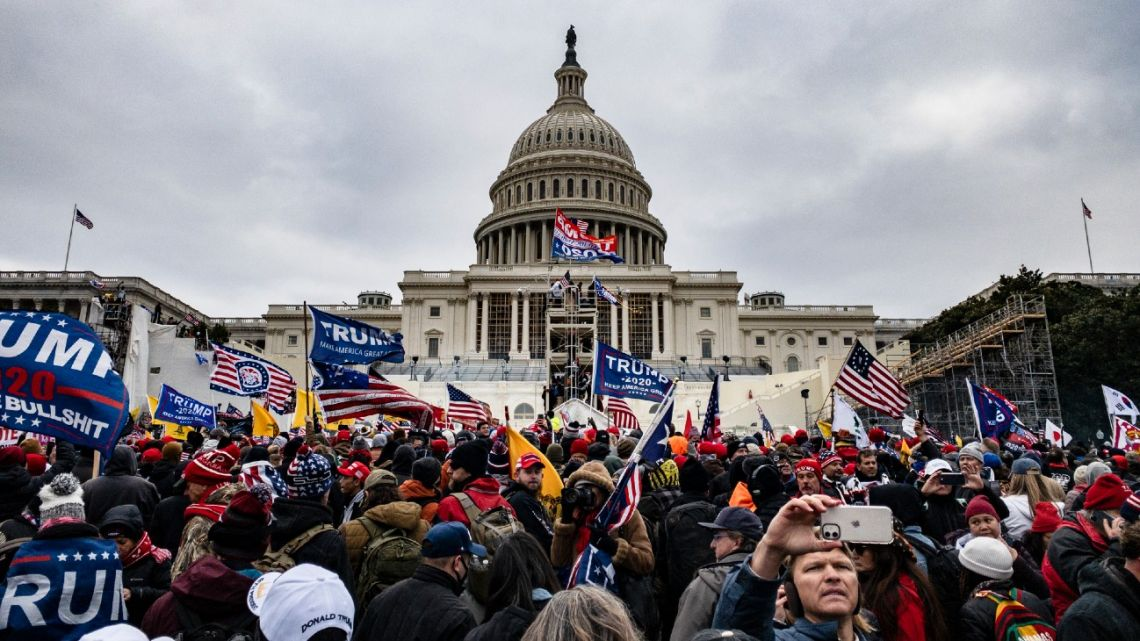 Pro-Trump supporters storm the US Capitol following a rally with President Donald Trump on January 6, 2021 in Washington, DC.