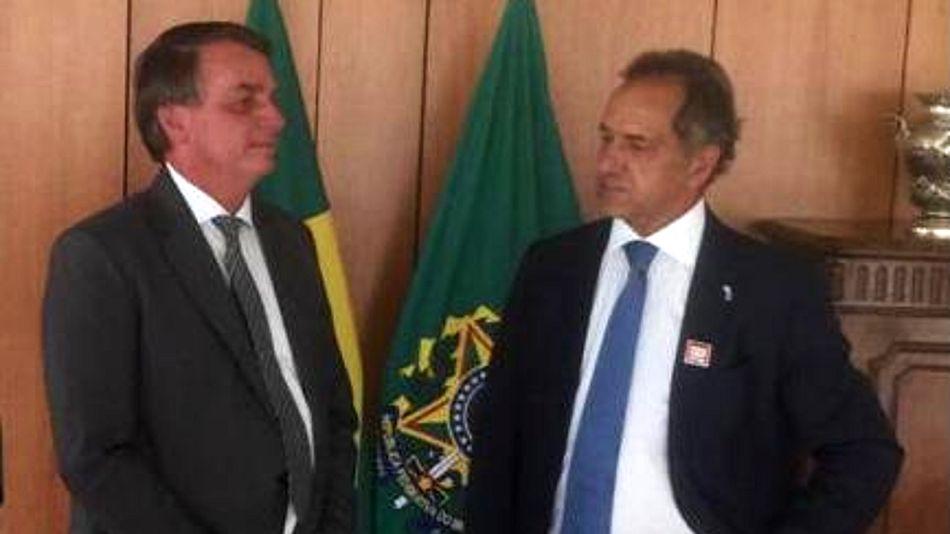 El presidente de Brasil Jair Bolsonaro junto a Daniel Scioli.