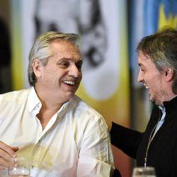 President Alberto Fernández shares a joke with Máximo Kirchner.