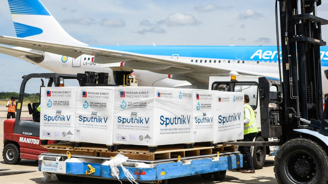 An Aerolíneas Argentina plane carrying 300,000 doses of the second shot of Russia's Sputnik V vaccine arrives at Ezeiza International Airport.