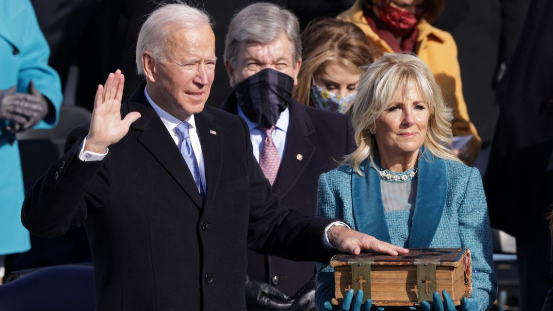Joe Biden is sworn in as US president as his wife, Dr. Jill Biden, looks on during his inauguration on the West Front of the US Capitol on January 20, 2021 in Washington DC.