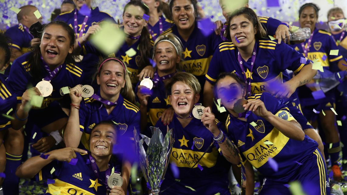 Players from Boca Juniors' women's team celebrate winning the Transicion 2020 title, after defeating River Plate 7-0.