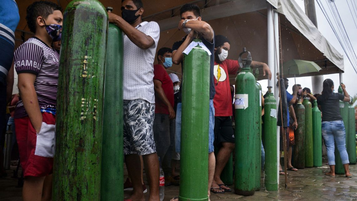 Relatives of patients infected with Covid-19 queue for long hours to refill their oxygen tanks at the Carboxi company in Manaus, Amazonas state, Brazil, on January 19, 2021. 21.