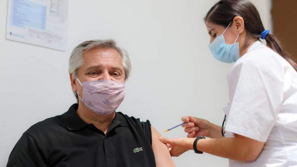 President Alberto Fernández receives the first jab of the Sputnik V coronavirus vaccine.