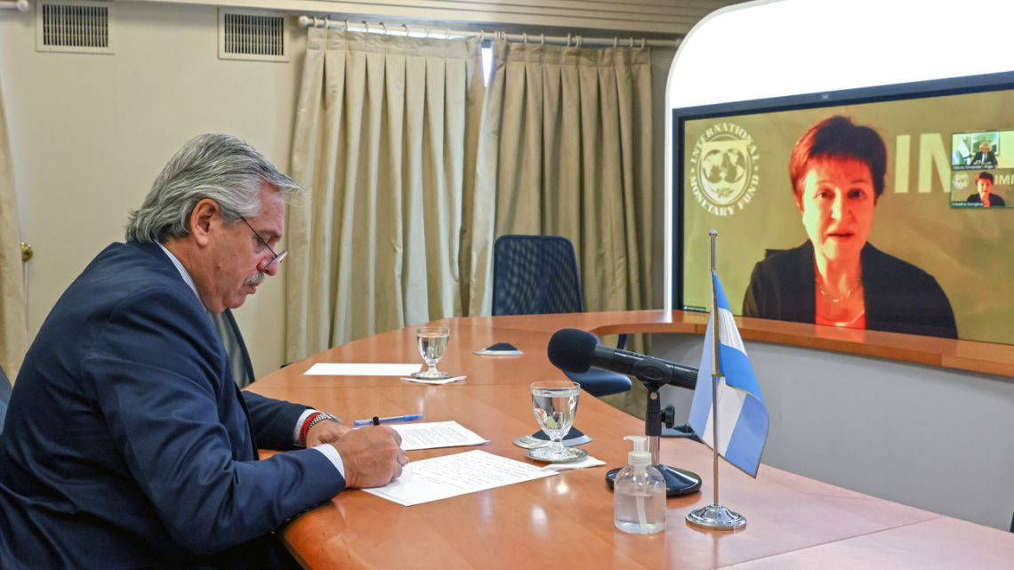 Handout photo released by the Presidency shows President Alberto Fernández speaking through video-call with the director of the International Monetary Fund (IMF) Kristalina Georgieva at the presidential residence in Olivos on January 21, 2021.