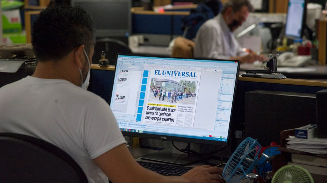 Newspaper layout designers work in the newsroom of the El Universal newspaper in Mexico City, on January 11, 2021.