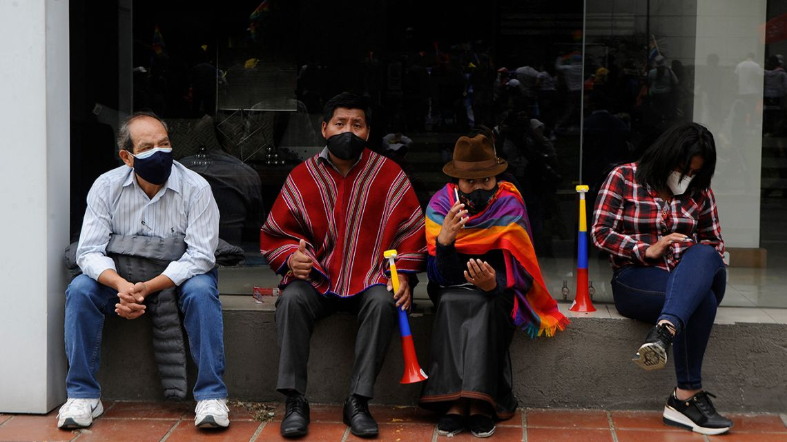 Supporters of the Ecuadorian Presidential candidate Yaku Perez are seen outside the Swissotel Hotel, where Perez is giving a press conference, in Quito, Ecuador, on February 8, 2021.