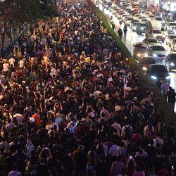 Los manifestantes a favor de la democracia participan en una manifestación que exige el fin de la ley de difamación real de Tailandia y para preservar la democracia en Tailandia y el vecino Myanmar, en Bangkok.   Foto:Mladen Antonov / AFP