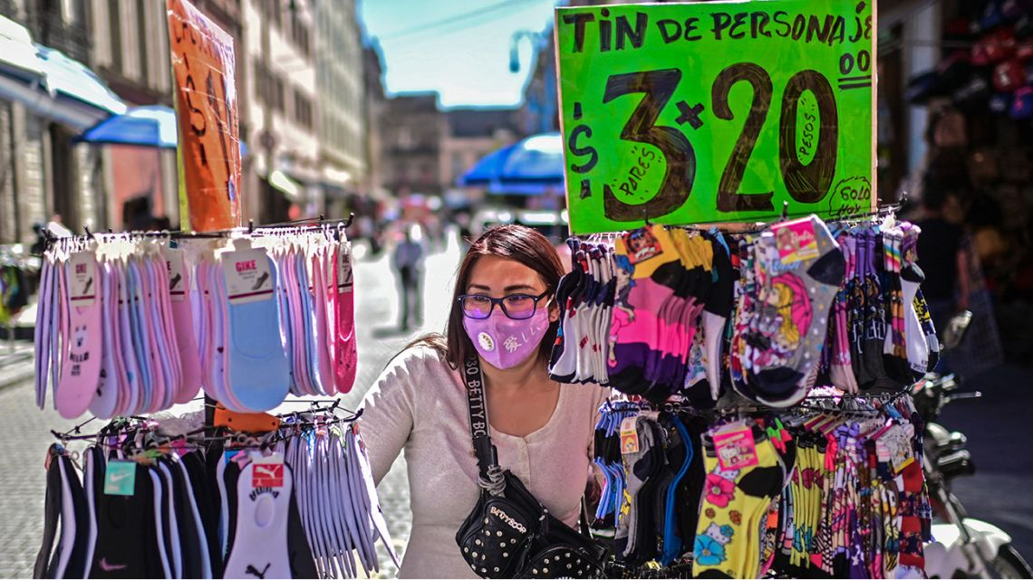 A vendor is seen in downtown Mexico City, on February 3, 2021, amid the new coronavirus pandemic.