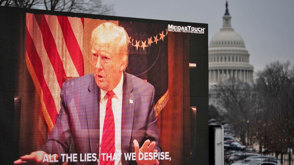 A video billboard calling for the conviction of former US president Donald Trump plays near the US Capitol, on the fourth day of Trump's second impeachment trial in Washington DC.