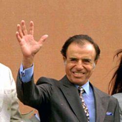 Carlos Menem con Néstor y Cristina Kirchner   Foto:cedoc