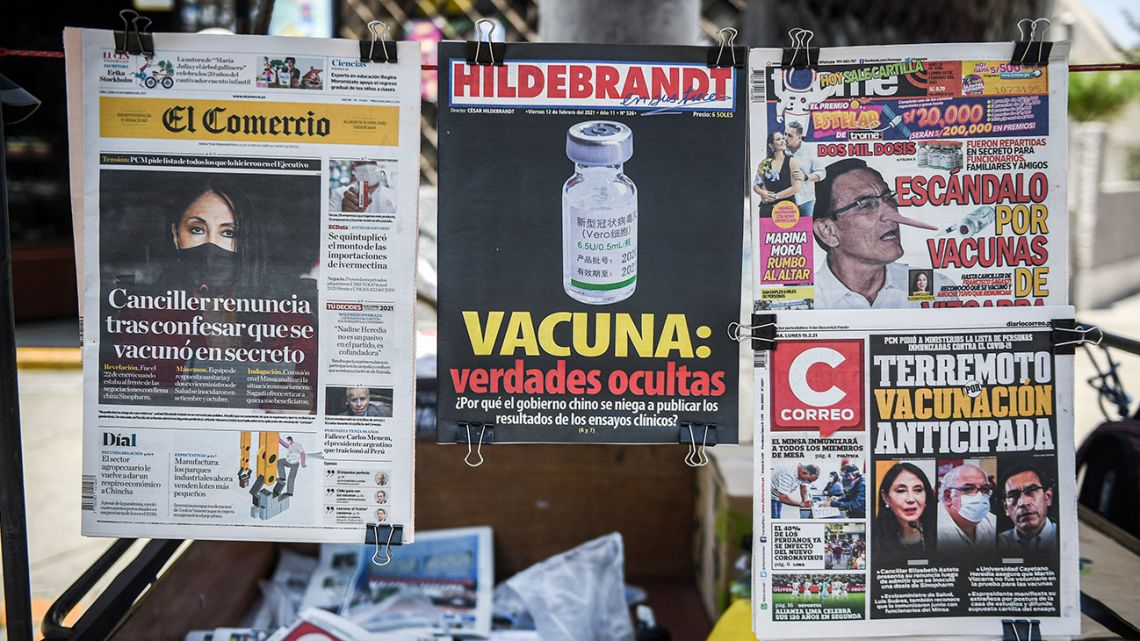 A newsstand in Lima displays on February 15, 2021 newspapers highlighting an early vaccination scandal involving politicians and top officials, amid the novel coronavirus COVID-19, pandemic.