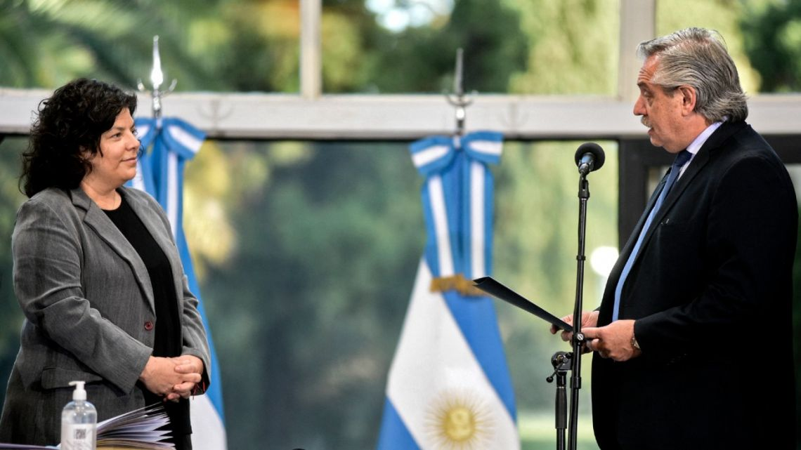 Handout photo released by the Presidency shows Alberto Fernández swearing in his new Health Minister Carla Vizzotti at the Olvios presidential residence on February 20, 2021. Vizzotti, formerly Health Access Secretary, replaces Ginés González García.