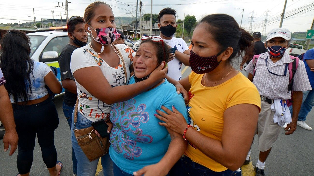 Relatives of the prisoners at the Zone 8 Deprivation of Liberty Center are seen as they wait for news, in Guayaquil, Ecuador, on February 23, 2021.