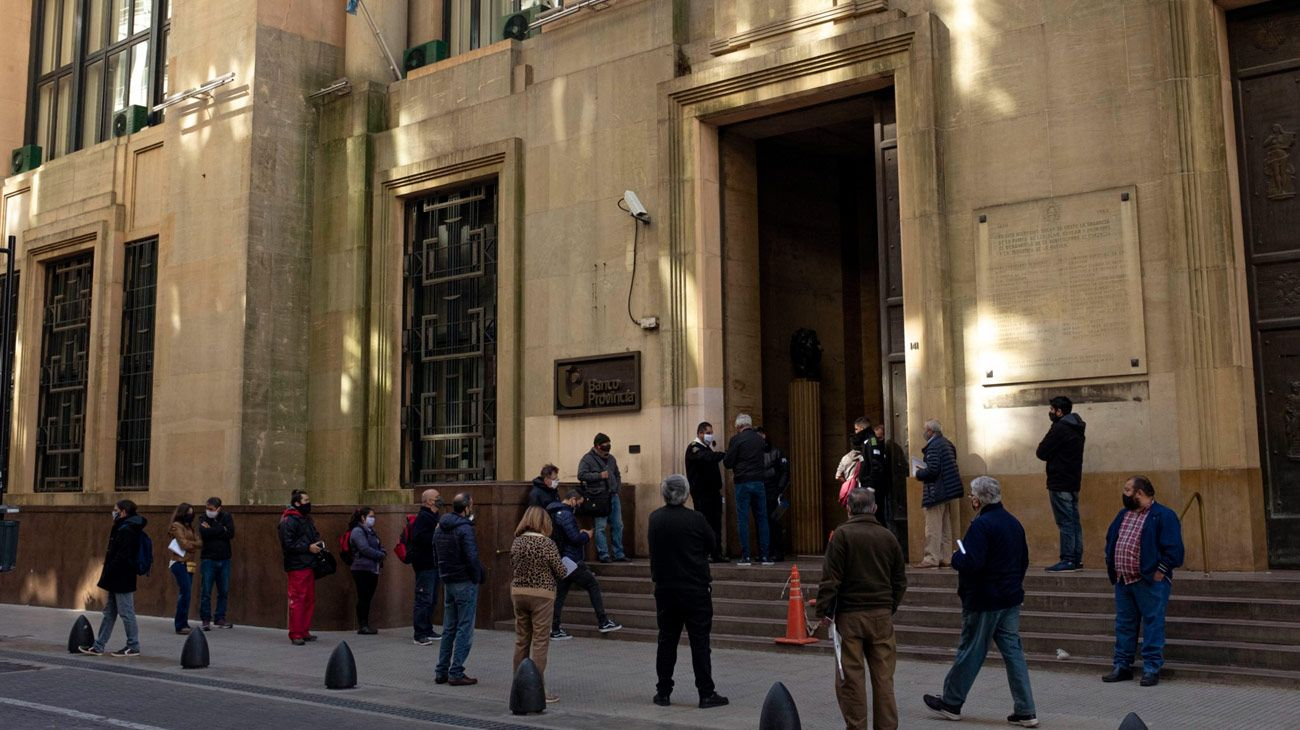 Customers queue outside a branch of Banco Provincia.
