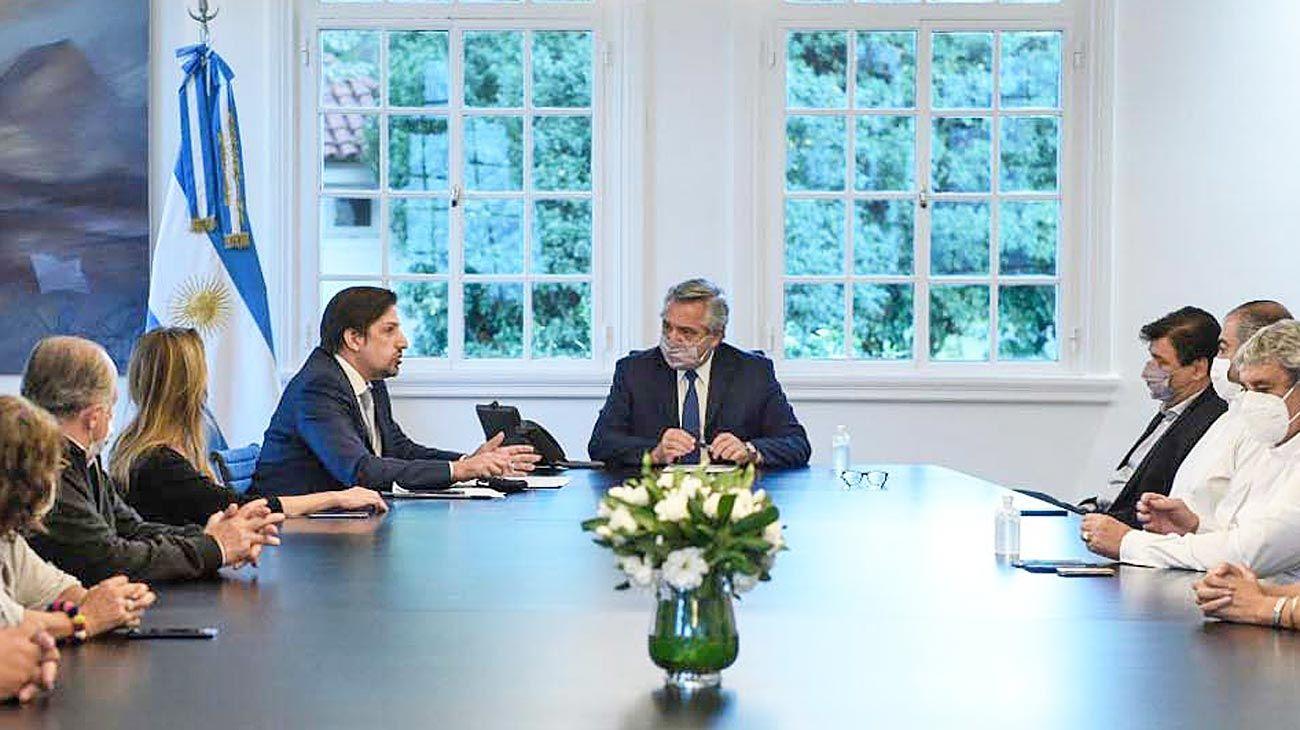 Firmas. Los gremios y el Ejecutivo se reunieron ayer por la tarde en Olivos. Fernández y Trotta ratificaron los acuerdos.