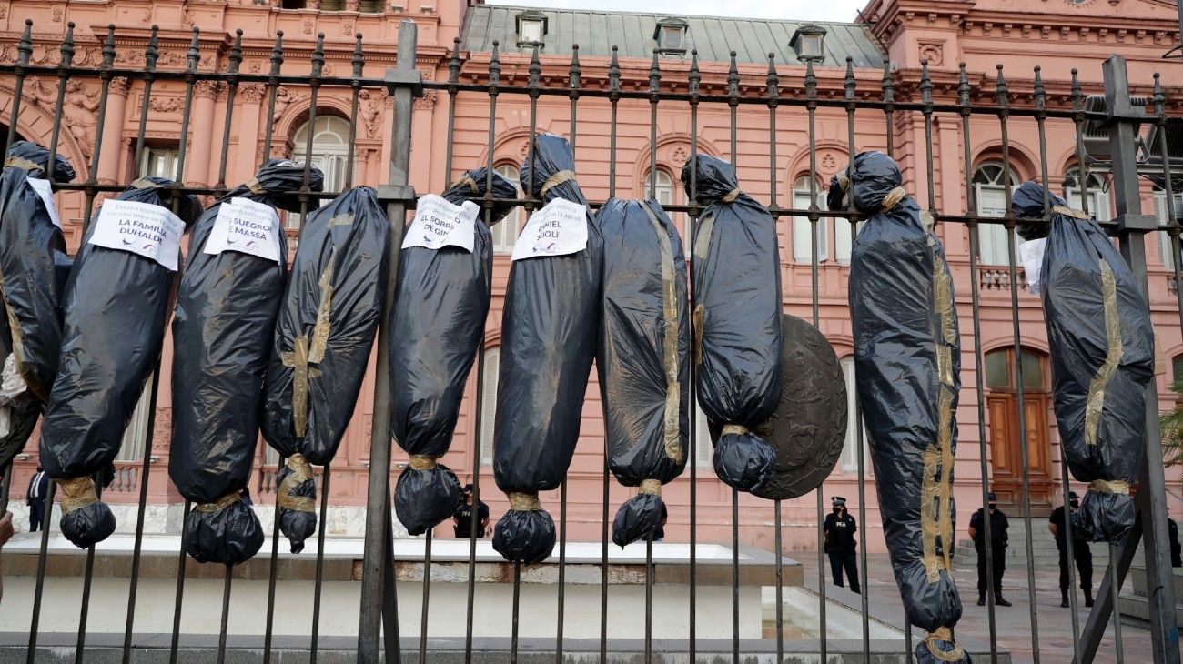 Mock body bags displayed by demonstrators are seen in front of the Casa Rosada in Buenos Aires, on February 27, 2021, during a protest against the government of President Alberto Fernández over the VIP vaccination scandal.
