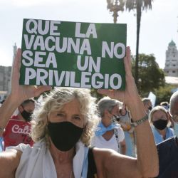 People protest against the government of President Alberto Fernández, following a scandal over coronavirus vaccine queue-jumping that forced his health minister to resign.