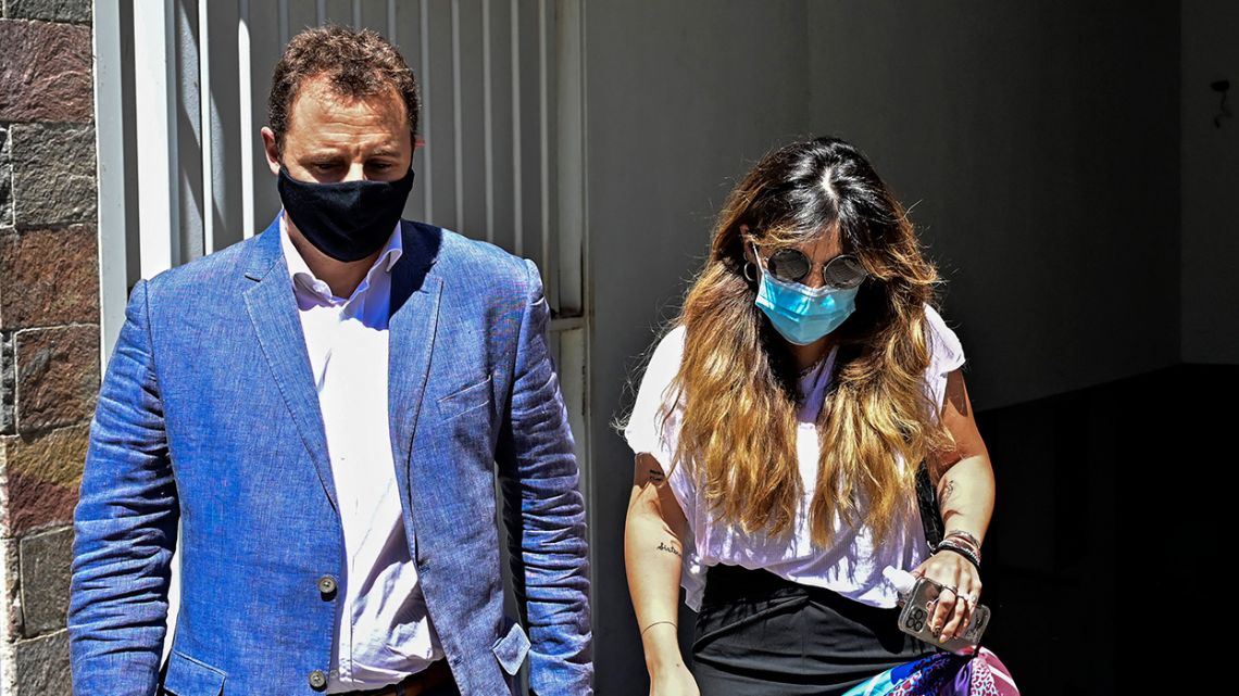 Giannina Maradona (R), daughter of late Argentine football star Diego Maradona, arrives at the public prosecutor's office accompanied by her lawyer Federico Guntin in San Isidro municipality, Buenos Aires province, Argentina, on February 26, 2021.