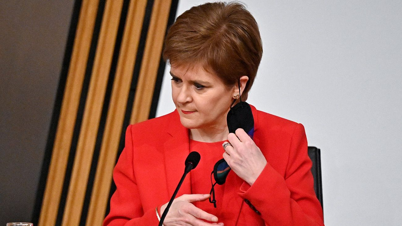 Scotland's First Minister Nicola Sturgeon removes her face covering as she arrives to give evidence to The Committee on the Scottish Government Handling of Harassment Complaints at Holyrood in Edinburgh, examining the government's handling of harassment allegations against former Scottish National Party leader and former first minister of Scotland, Alex Salmond on March 3, 2021.