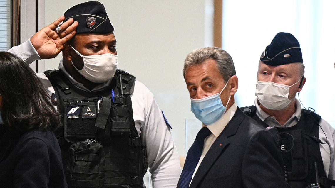 Former French president Nicolas Sarkozy arrives at the Paris court house to hear the final verdict in a corruption trial on March 1, 2021.