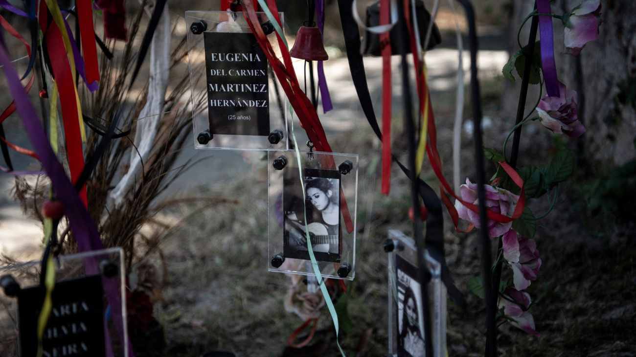 View of pictures of female victims of Augusto Pinochet's regime at an altar outside the Venda Sexy former clandestine detention centre, in Santiago, on November 21, 2020.