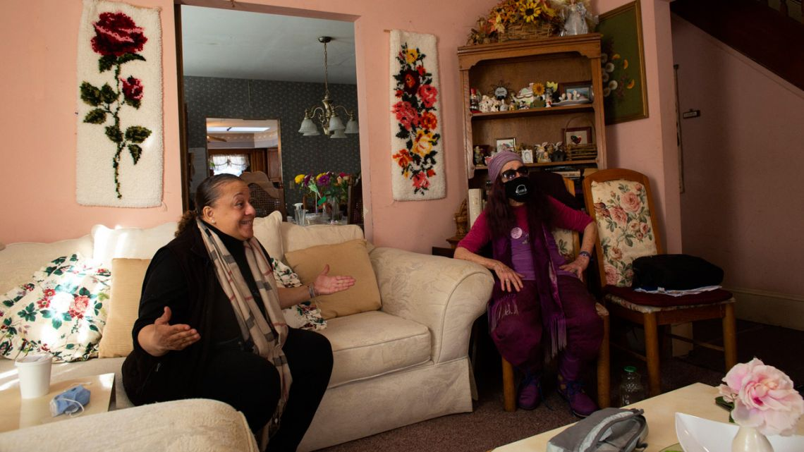 Cheryl Bullock-Hannah (left), a volunteer at 'Strengthen Our Sisters' shelter, speaks during a interview next to Sandra Ramos (right), director of the shelter, in Paterson, New Jersey on February 25, 2021.