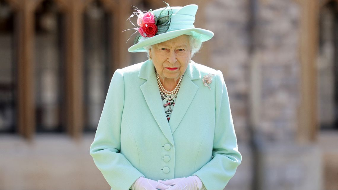 In this file photo taken on July 17, 2020 Britain's Queen Elizabeth II poses after confering the honour of a knighthood upon 100-year-old veteran Captain Tom Moore during an investiture at Windsor Castle in Windsor, west of London.