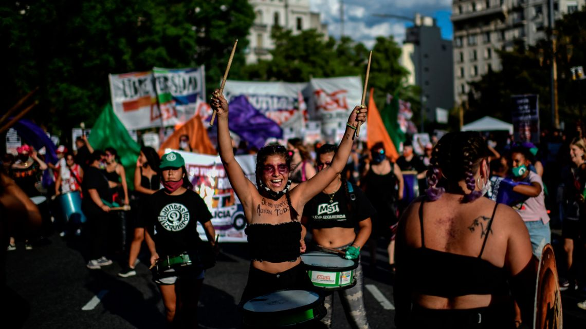 Women march during a demonstration marking International Women's Day in Buenos Aires, on March 8, 2021.
